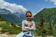 Cute little girl in high mountains, summer stock photography