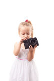Cute little girl hold old film camera isolated Royalty Free Stock Images