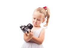 Cute little girl hold old film camera isolated Stock Photography