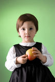 Cute little girl holding apple Stock Photo
