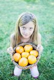 Cute little girl holding a basket Royalty Free Stock Photo