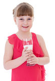 Cute little girl is holding big glass of milk Stock Image