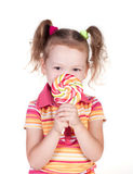 Cute little girl holding big lolly pop Royalty Free Stock Images