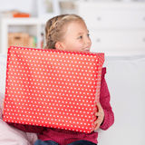 Cute little girl holding big present box Royalty Free Stock Photography