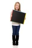 Cute little girl holding blackboard Royalty Free Stock Image