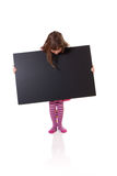 Girl with a blank sign Royalty Free Stock Images