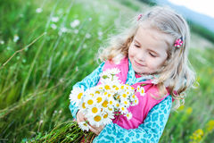 Cute little girl holding a bouquet Stock Images