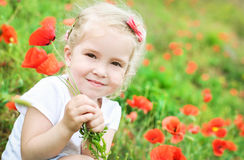 Cute little girl holding a bouquet Stock Photos