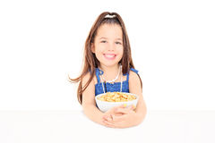 Cute little girl holding a bowl of cereal Royalty Free Stock Photos