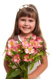 Cute little girl holding the bunch of flowers Stock Photos