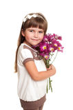 Cute little girl holding the bunch of flowers Stock Photo