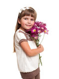 Cute little girl holding the bunch of flowers Royalty Free Stock Photos