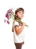 Cute little girl holding the bunch of flowers Royalty Free Stock Image