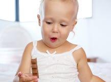 Cute little girl holding chocolate Stock Photo