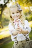 Cute Little Girl Holding Christmas Candy Canes Outdoors Stock Images