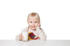 Cute little girl holding a cup of milk, isolated on white Stock Photos
