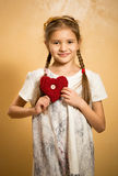 Cute little girl holding decorative red heart Stock Photography