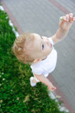 Baby girl with flower Royalty Free Stock Photo