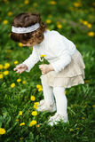 Cute little girl holding flowers Royalty Free Stock Images