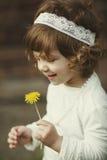 Cute little girl holding flowers Stock Image