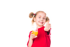 Cute little girl holding glass with juice with thumb up. Cute little girl holding glass with juice smiling  with thumb up isolated on white Stock Images