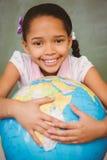 Cute little girl holding globe Stock Image