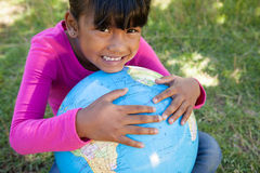 Cute little girl holding globe Stock Images