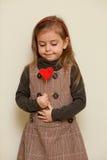Cute little girl holding  heart shape. Portrait of a cute little girl holding heart shape Stock Photo