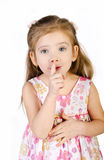Cute little girl is holding her finger near the mouth isolated Royalty Free Stock Photo