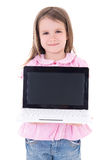 Cute little girl holding laptop with blank screen isolated on wh Stock Image