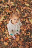 Cute little girl holding leaf in hand Royalty Free Stock Photo