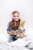 Cute little girl holding a mascot rabbit. Over the white background Royalty Free Stock Images