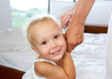 Cute little girl holding mother hands Stock Photos