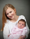 Cute little girl holding a new born baby Royalty Free Stock Photography