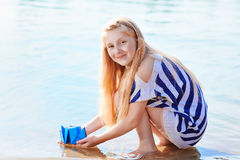 Cute little girl holding origami boat outdoors Royalty Free Stock Photography