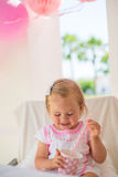 Cute Little Girl Holding Paper Pink Cup Royalty Free Stock Image