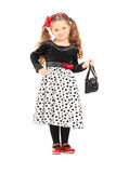 Cute little girl holding a purse Royalty Free Stock Images