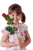Little girl with a rose Royalty Free Stock Images