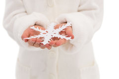 Cute little girl holding snowflake Stock Images