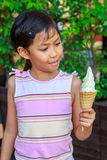 Cute little girl holding soft ice cream in hand Royalty Free Stock Image