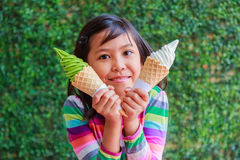 Cute little girl holding soft ice cream in hand Stock Images