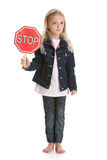 Cute little girl holding a stop sign on white Royalty Free Stock Photos