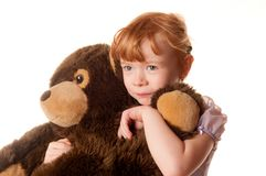 Cute little girl holding a teddy bear Royalty Free Stock Photography