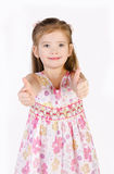 Cute little girl holding thumbs up isolated. On white Stock Image