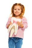 Cute little girl holding tooth model in her hands Stock Photo