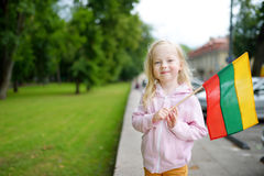 Free Cute Little Girl Holding Tricolor Lithuanian Flag Stock Image - 84439891