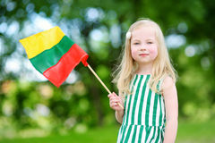 Cute little girl holding tricolor Lithuanian flag Royalty Free Stock Photo