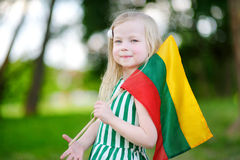 Cute little girl holding tricolor Lithuanian flag Stock Photography
