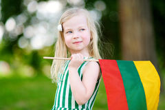 Cute little girl holding tricolor Lithuanian flag Royalty Free Stock Images