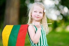 Cute little girl holding tricolor Lithuanian flag Royalty Free Stock Image
